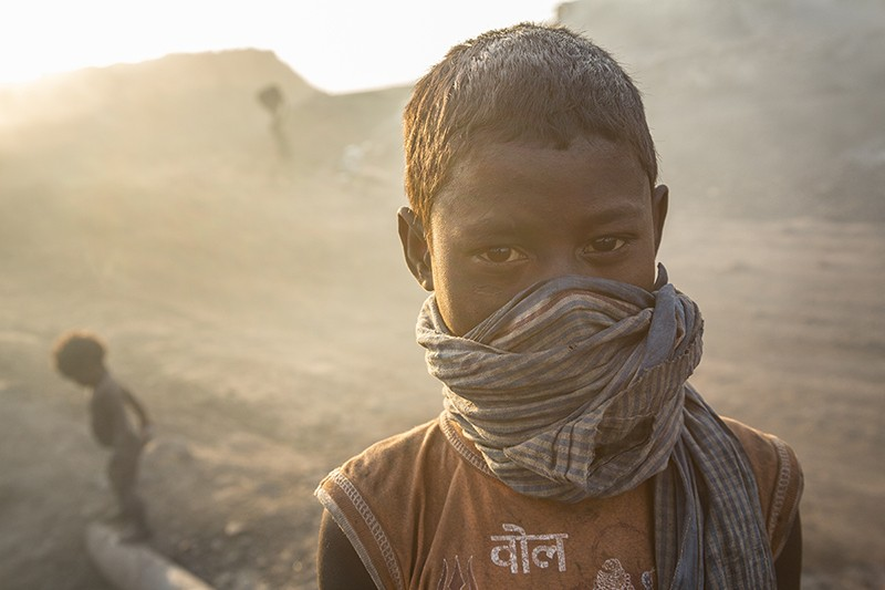 Child with cloth covering his mouth and nose