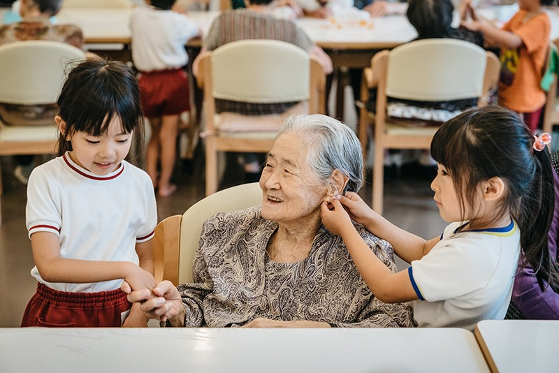 Children talking with elderly woman in South Korea