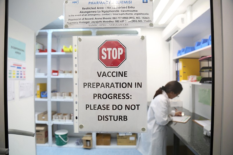 Pharmacist works in the laboratory where the HIV vaccines are prepared.