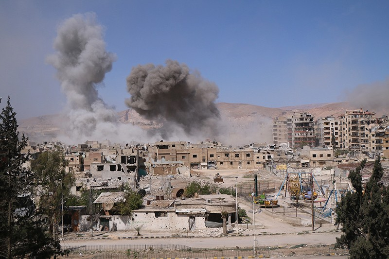 Smoke rises after Assad Regime forces carried out airstrikes in Eastern Ghouta's Douma town in Damascus, Syria on April 07, 2018