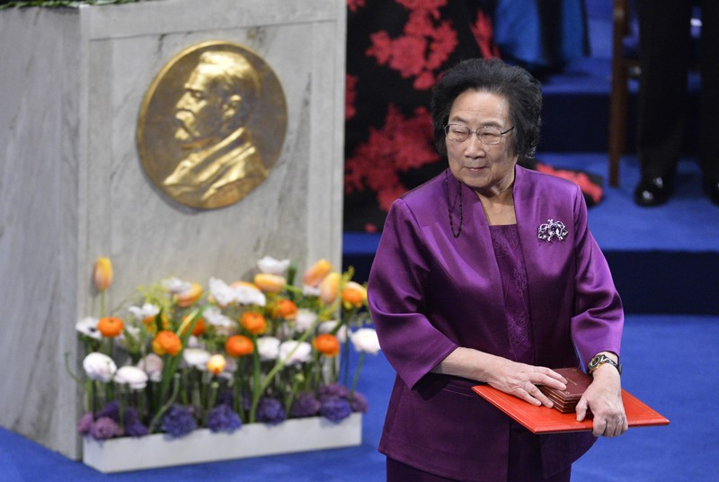 Tu Youyou leaves the stage after receiving her medal during the 2015 Nobel prize award ceremony