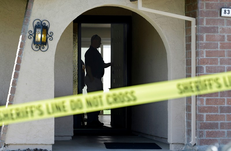 Authorities search the home of a suspected killer