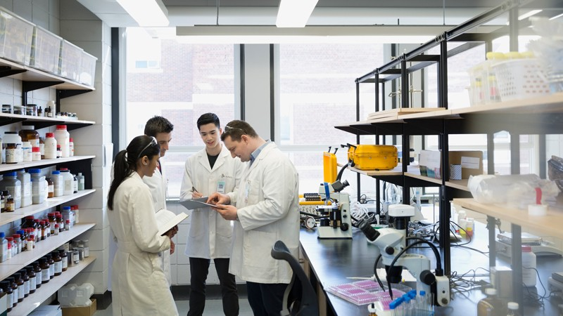 Scientists meeting in a laboratory