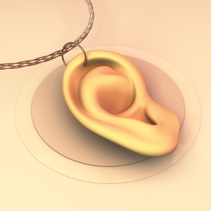 Artistic illustration of an ear on a necklace
