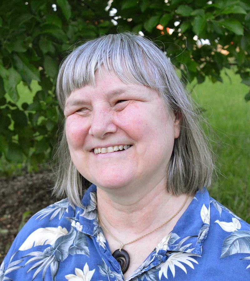 Portrait of Professor Sheri Wells-Jensen taken outside