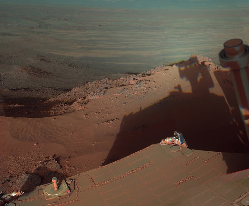 The Opportunity rover snaps a picture of its shadow stretching towards Endeavour Crater on Mars in 2012.