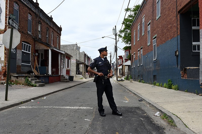 A policeman stands in the street in Camden, New Jersey