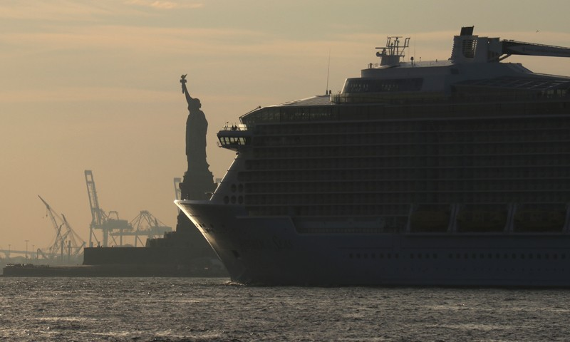 A cruise ship passes the Statue of Liberty