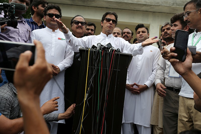 Cricket star-turned-politician Imran Khan after casting his vote during the general election in Pakistan in July.