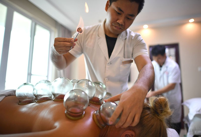 A patient is treated with heated cups at a traditional-medicine clinic in Shanghai.