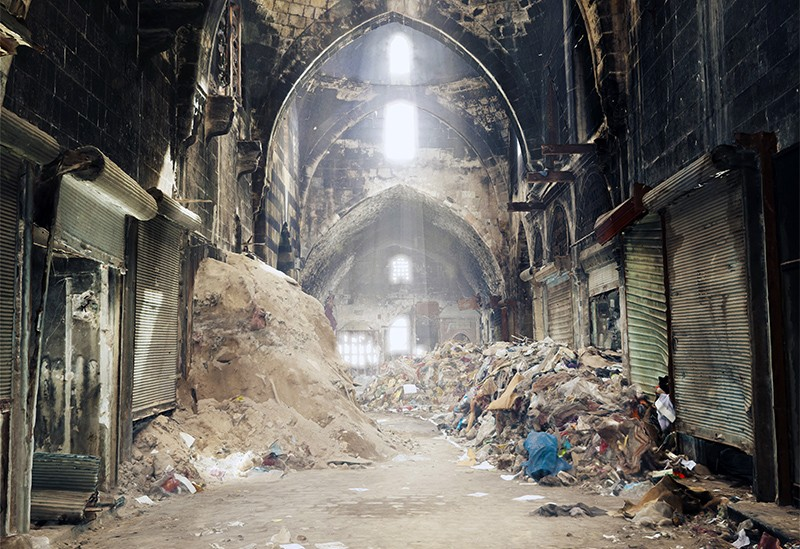 3D image of Aleppo Souk in Syria. Rubble and rubbish are on the floor, light streams in from windows in high arches