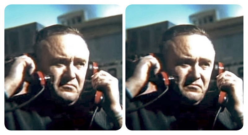 Stereoscopic view of Sergei Korolev holding up a phone to each ear.