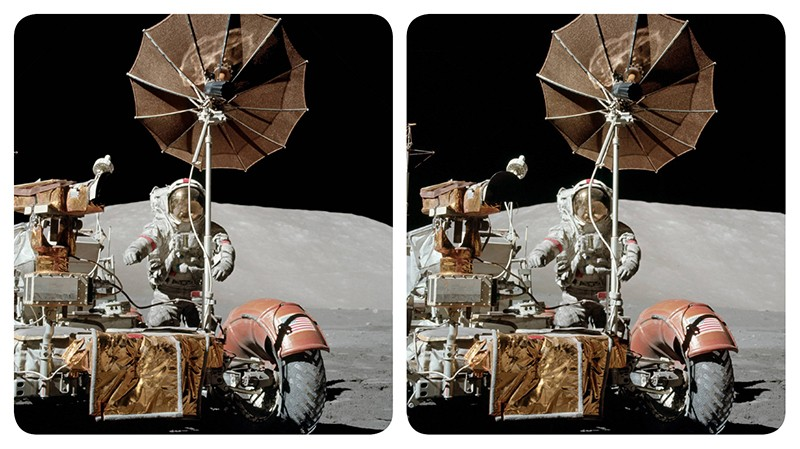 Stereoscopic image of astronaut Gene Cernan standing next to a parked lunar rover during an Apollo 17 moonwalk