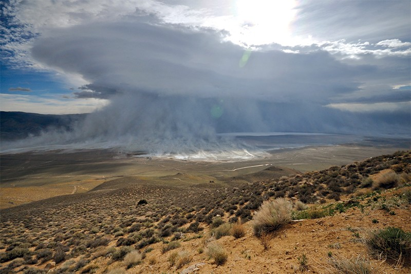 A huge dust cloud forming over Owens Valley and lake in 2010