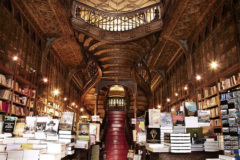 A grand bookshop with piles of books on tables