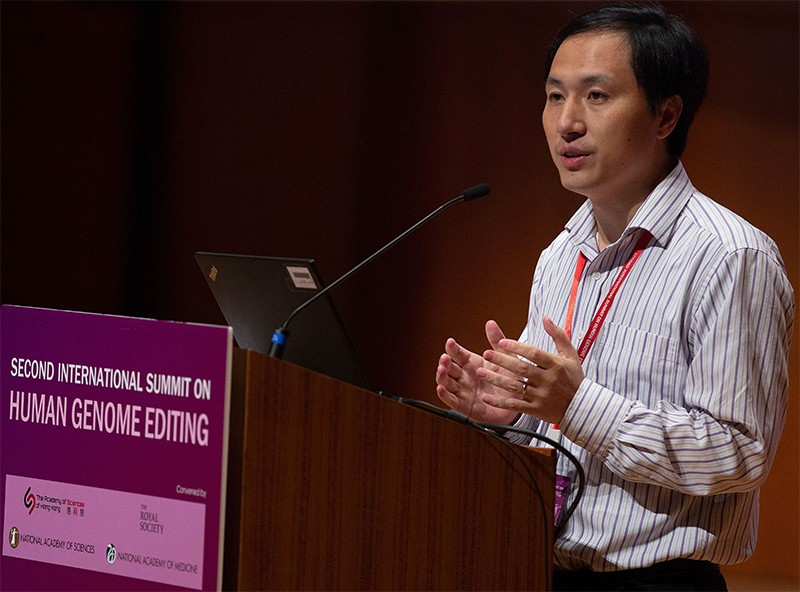 He Jiankui talks at a podium during his presentation on the 28th November.