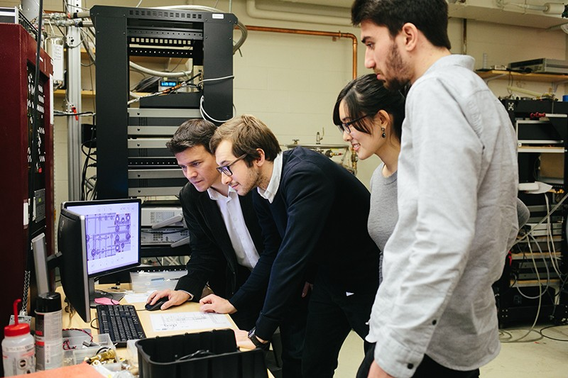 Graduate students at MIT work with physicist Pablo Jarillo-Herrero