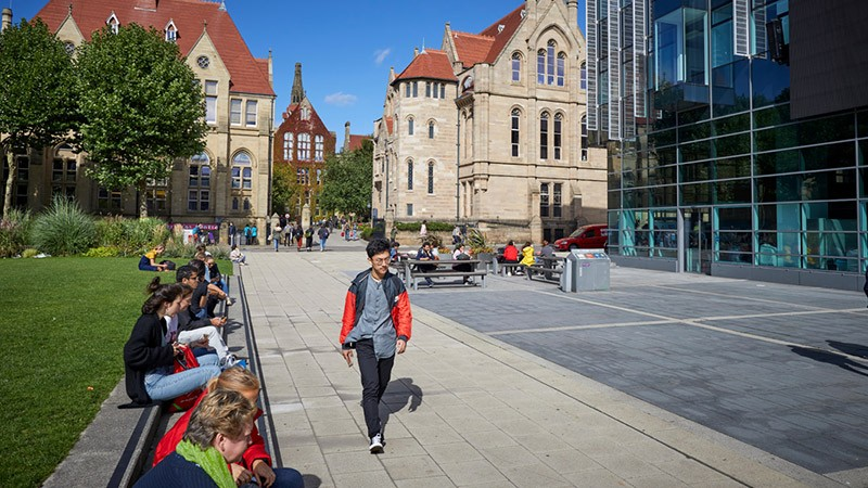 Students relaxing on the grass parks around Manchester