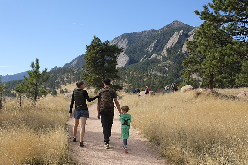 Mette (l) and Lars Lønsmann Iversen (c) walk with their son in Boulder, Colorado.
