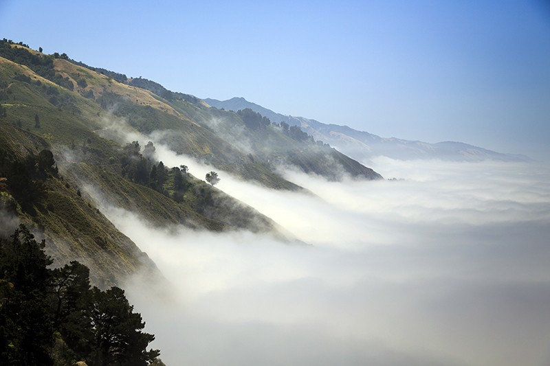 Pacific ocean fog fills the coastal valleys on Big Sur, California