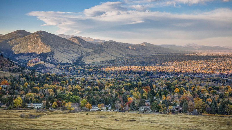 Autumnal aerial view of Boulder Colorado and Rocky Mountains from Chautauqua Park.