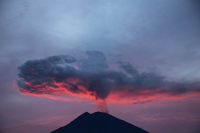 View of Mount Agung erupting in the afternoon.
