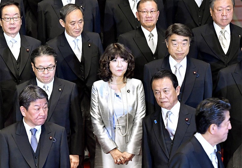 Satsuki Katayama stands among her cabinet minister colleagues