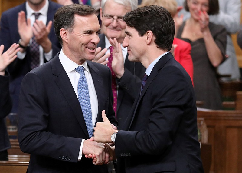 Canada's Finance Minister Bill Morneau shakes hands with Prime Minister Justin Trudeau