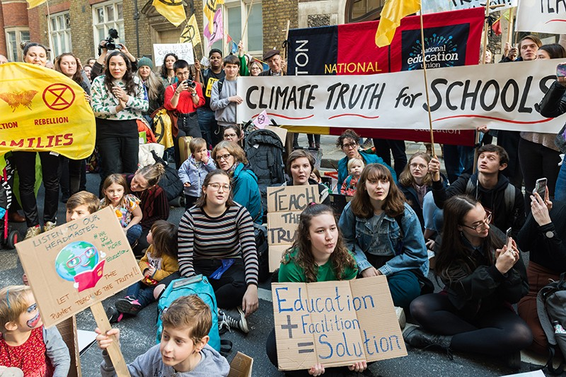 Protesters in London against inadequate climate change education.