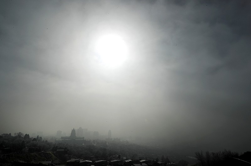 The Utah State Capitol is shrouded in smog in downtown Salt Lake City.
