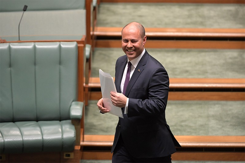 Treasurer Josh Frydenberg smiles after delivering the budget in the House of Representatives in Australia