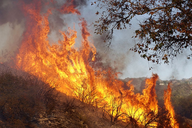 A wildfire burns at the Salvation Army Camp on November 10, 2018 in Malibu, California.