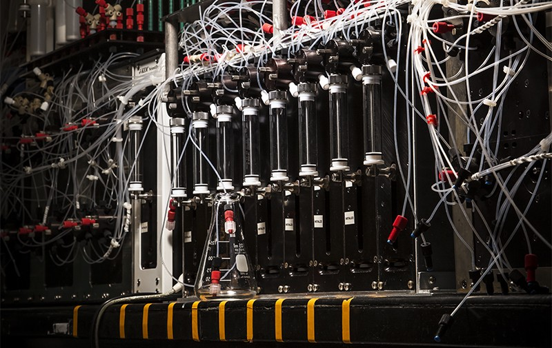 Close up view of dials and wires on Marty Burke's synthesis machine which assembles complex molecules robotically.