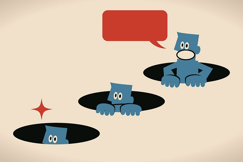 Illustration of 3 nervous blue people poking their heads out of holes in the ground to look and comment.