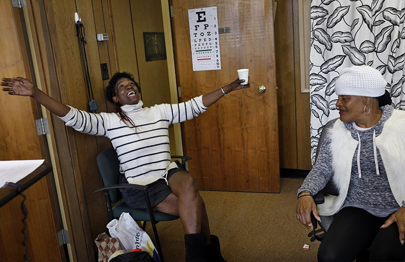 Kimberly Lea (left) talks with another client, Vernada Jones at Hope Home in Oakland, Calif.