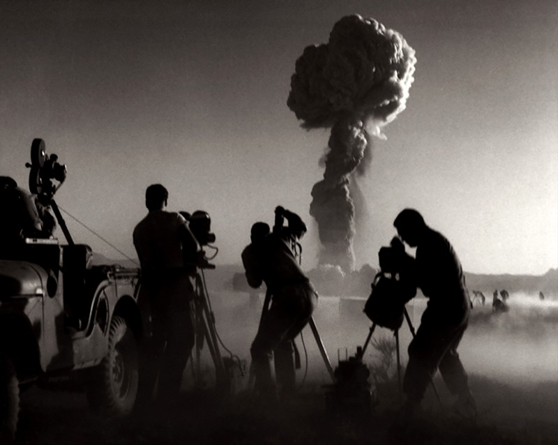 Government filmmakers document an atomic bomb explosion at the test site in Nevada. 1957