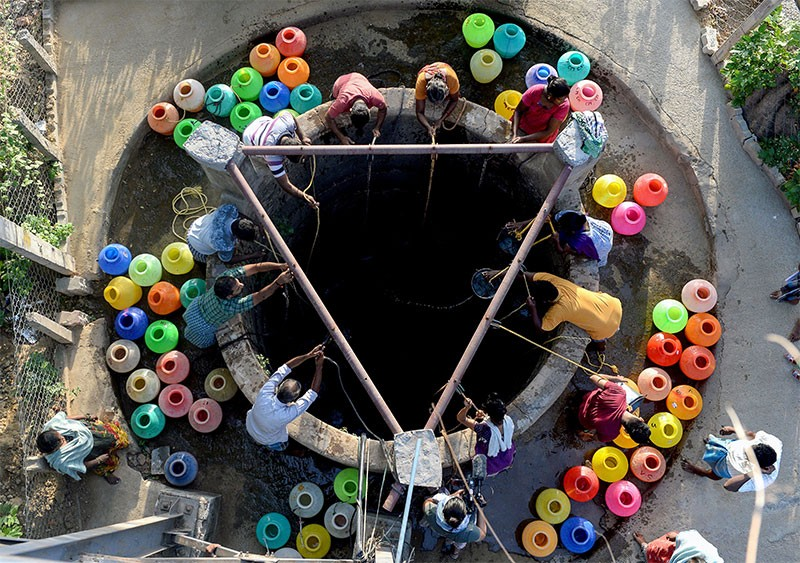 Indian residents get water from a community well in Chennai after reservoirs for the city ran dry