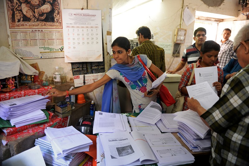 Indian students pick up photocopied material from the Rameshwari Photocopy Service shop