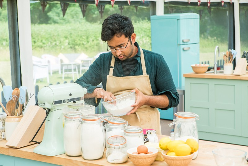Rahul Mandal in the Great British Bake Off tent in 2018.