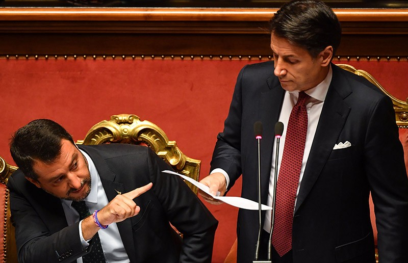 Italian Prime Minister Giuseppe Conte delivers a speech at the Italian Senate flanked by Deputy Prime Minister Matteo Salvini