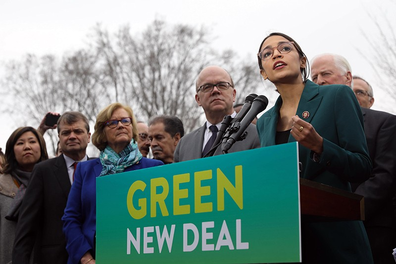 U.S. Rep. Alexandria Ocasio-Cortez of New York, along with other members of Congress, announce the Green New Deal legislation