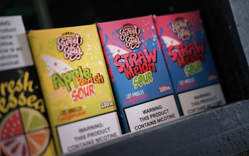 Vaping products, including flavored vape liquids and pods.