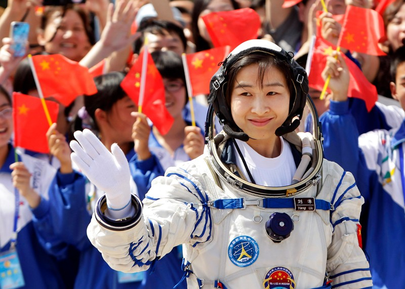 Liu Yang, China's first female astronaut, waves during a departure ceremony at Jiuquan Satellite Launch Centre