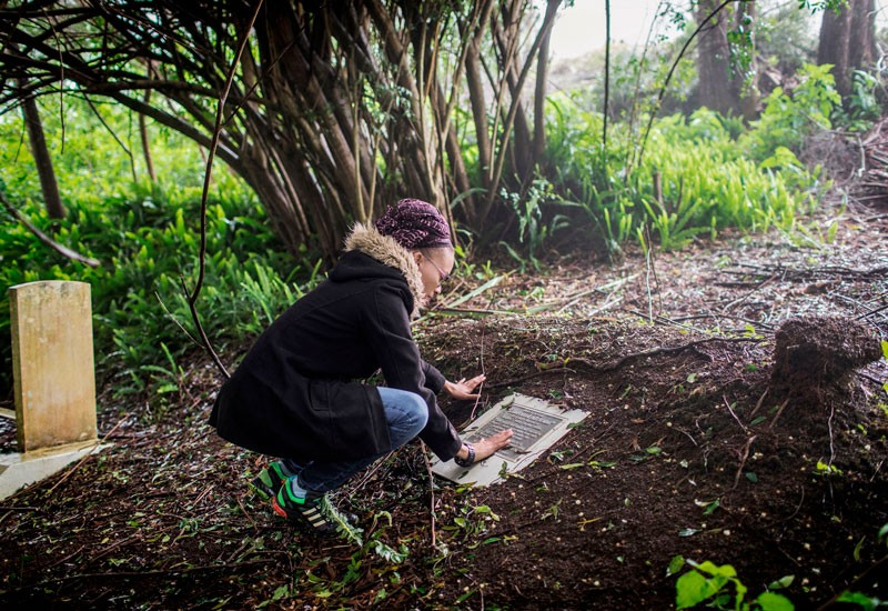 Annina Van Neel Hayes looks at a plaque commemorating the burial place of the remains of some liberated African slaves.
