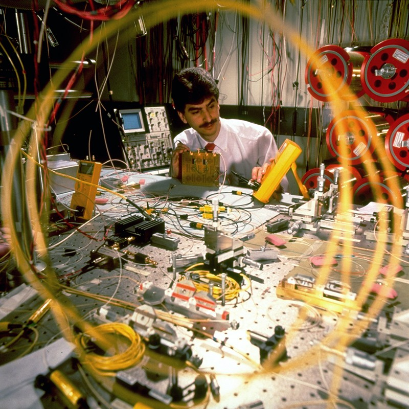 A Bell Labs researcher working on optical fiber in a lab test, 1991