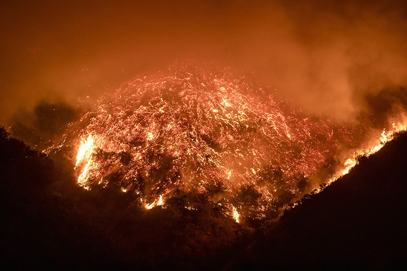 The Getty fire burns a hillside next to the 405 freeway in Los Angeles on 28 October 2019.