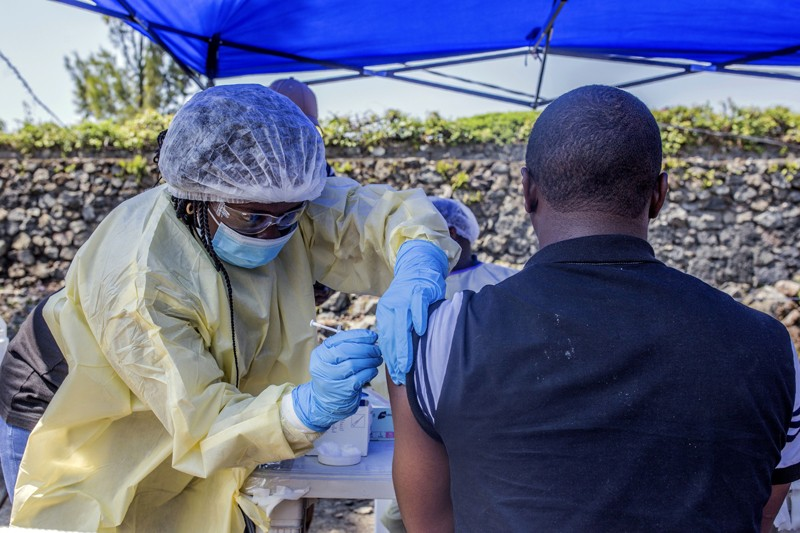 A man receives a vaccine against Ebola from a nurse