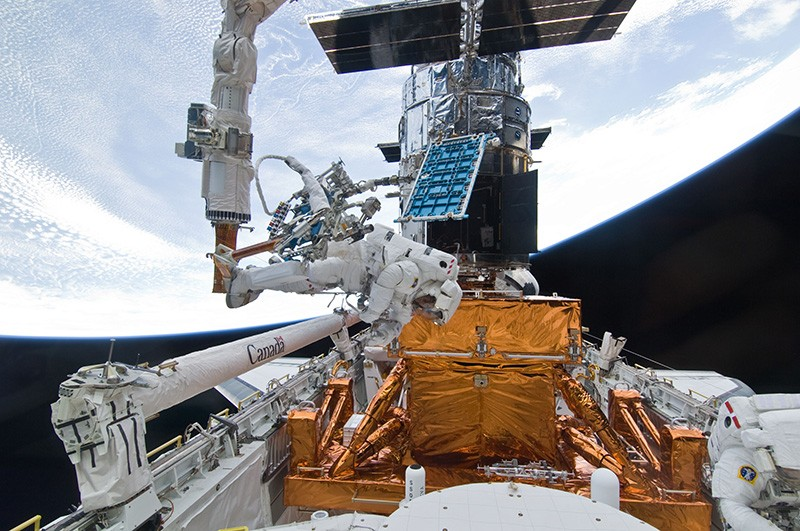 Astronauts on the Space Shuttle Atlantis refurbish and upgrade the Hubble Space Telescope.