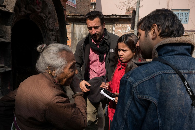 Researchers interview local residents in Kathmandu after the earthquake in 2015