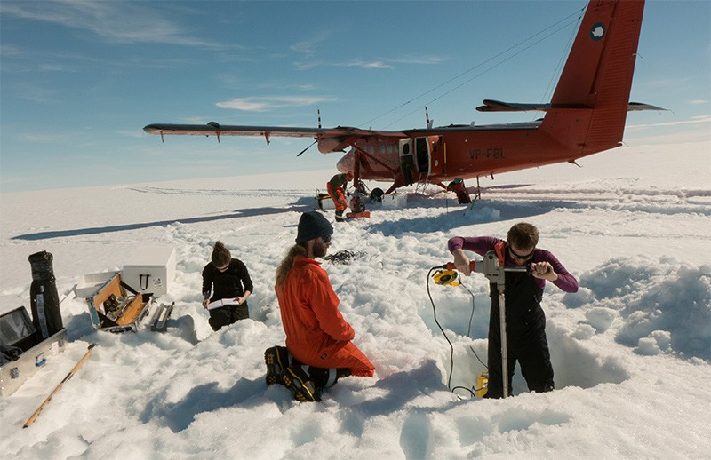 Photo of researchers collecting cores from the George VI Ice Shelf, Antarctica